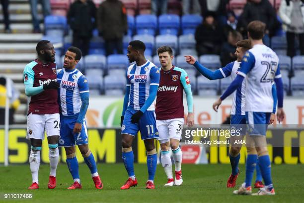 Arther Masuaku of West Ham United receives a red card for spitting during the The Emirates FA Cup Fourth Round match between Wigan Athletic and West...