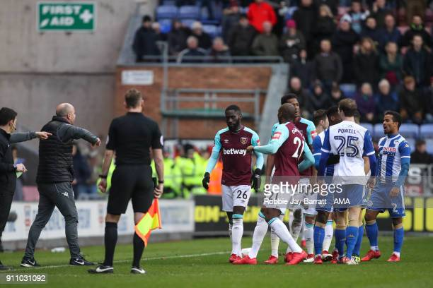 Arther Masuaku of West Ham United receives a straight red card for spitting during the The Emirates FA Cup Fourth Round match between Wigan Athletic...
