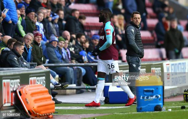 Arther Masuaku of West Ham United receives a straight red card for spitting during the Emirates FA Cup Fourth Round match between Wigan Athletic and...
