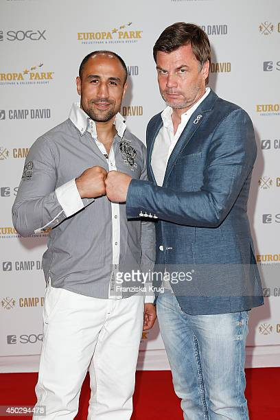 Arthur Abraham and Thomas Helmer attend the 'Fashion World Camp David und Soccx' Store Opening on June 08 2014 in Rust Germany