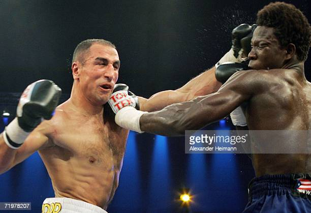 Arthur Abraham hits a punch on to Edison Miranda during the IBF World Championship Middleweight fight bewteen Arthur Abraham of Germany and Edison...