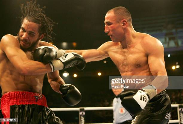 Arthur Abraham of Germany and Elvin Ayala of USA in action during the IBF World Championship Middleweight fight at the Kieler Ostsee Halle on March...