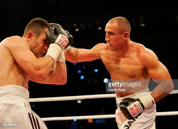 Arthur Abraham of Germany and Khoren Gevor of Germany compete during the IBF World Championship Middleweight fight between Arthur Abraham and Khoren...