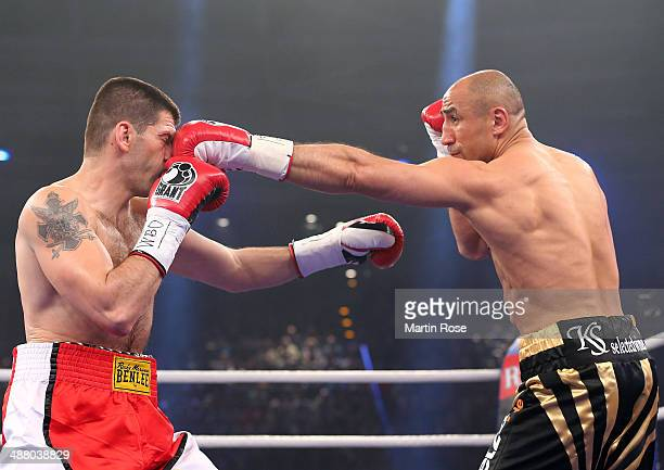 Arthur Abraham of Germany and Nikola Sjekloca of Montenegro exchange punches during the WBO World Championship Super Middleweight title fight at...