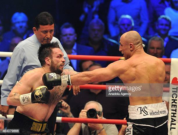 Arthur Abraham of Germany and Paul Smith of Great Britain exchange punches during the WBO World Championship Super Middleweight fight at O2 World in...
