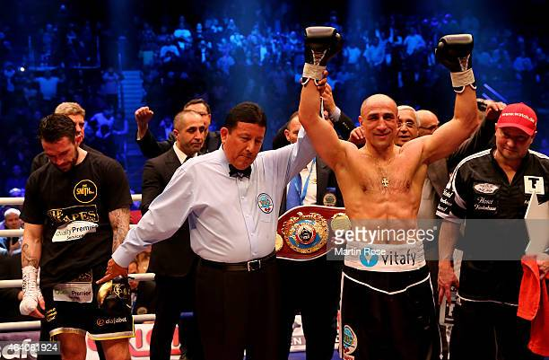 Arthur Abraham of Germany celebrates after beating Paul Smith of Great Britain during the WBO World Championship Super Middleweight title fight at o2...