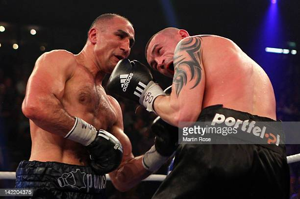 Arthur Abraham of Germany exchange punches with Piotr Wilczewski of Poland during their WBO supermiddleweight eleminator fight at Sparkassen Arena on...