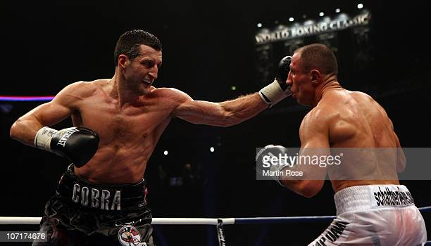 Arthur Abraham of Germany exchanges punches with Carl Froch of Great Britain during the WBC Super Middleweight fight during the 'Super Six World...