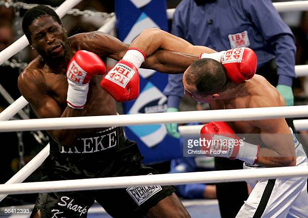 Arthur Abraham of Germany hits Kingsley Ikeke of Canada during the IBF World Championship middleweight fight at the Arena of Leipzig on December 10,...