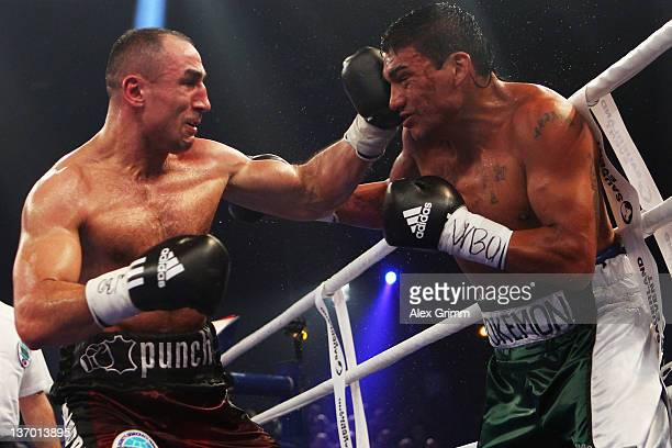Arthur Abraham of Germany hits Pablo Oscar Natalio Farias of Argentina during their WBO Europe Super middleweight title fight at BadenArena on...
