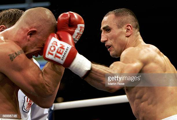 Arthur Abraham of Germany hits Shannon Taylor of Australia during the IBF world championship middleweight fight at the EWE Arena on March 4, 2006 in...