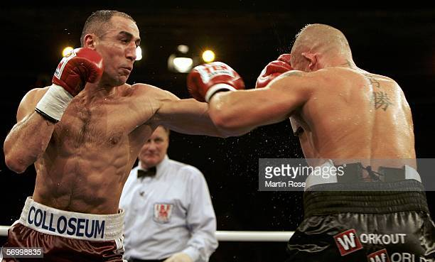 Arthur Abraham of Germany hits Shannon Taylor of Australia during the IBF world championship middleweight fight on March 4, 2006 in Oldenburg,...