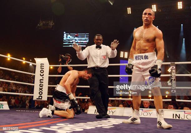 Arthur Abraham of Germany knocks down Mahir Oral of Germany during the IBF Middleweight title fight between Arthur Abraham and Mahir Oral at the...