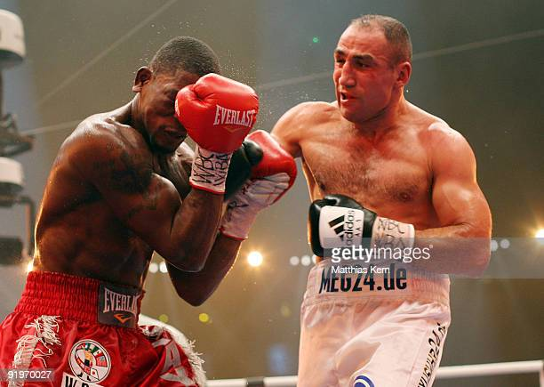 Arthur Abraham of Germany punches Jermain Taylor of the US during the WBC Super Middleweight fight during the 'Super Six World Boxing Classic' night...