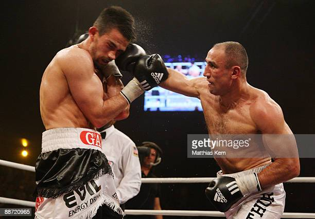 Arthur Abraham of Germany punches Mahir Oral of Germany during the IBF Middleweight title fight between Arthur Abraham and Mahir Oral at the...