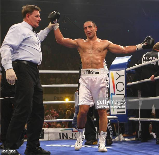 Arthur Abraham of Germany reacts as Ringreferee Wayne Kelly lift his arm after the technical knockout at round 6 during his IBF World Championship...
