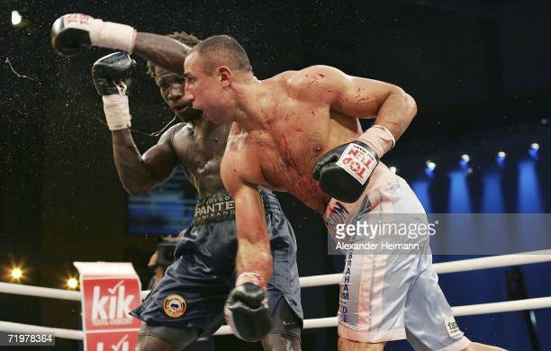 Arthur Abraham punches Edison Miranda during the IBF World Championship Middleweight fight between Arthur Abraham of Germany and Edison Miranda of...