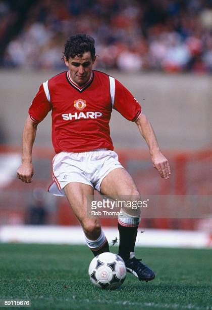 Arthur Albiston in action for Manchester United against West Ham United at Old Trafford in Manchester, 26th August 1985. Manchester United won 2-0.
