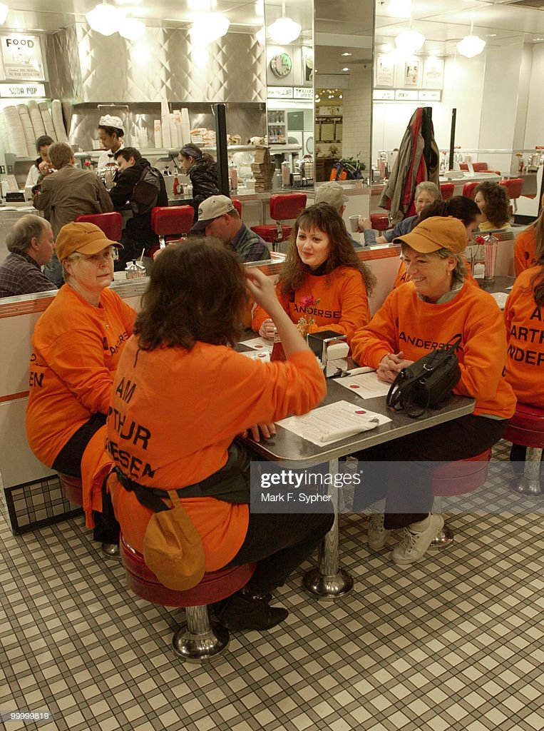 Arthur Anderson employees, clockwise from left, Jan Fox, Jen Fleming, Dab Hannah and Tharesa Miseyko, discuss their protest plans over breakfast at Union Station before heading to Capitol Hill to demonstrate. Their shirts read 'I am Arthur Anderson.'