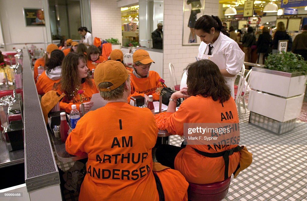 Arthur Anderson employees, clockwise from left, Jen Fleming, Deb Hannah, Tharesa Miseyko and Jan Fox fuel up at Union Station before a day of protesting on Capitol Hill on Thursday.