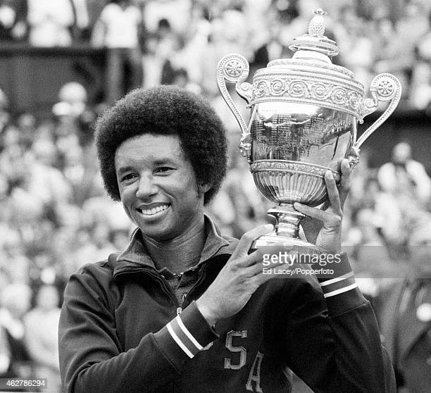 Arthur Ashe of the United States holding the Wimbledon trophy after winning the Men's Singles final, defeating Jimmy Connors of the United States in...