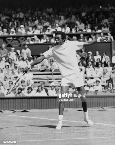 Arthur Ashe of the United States makes a backhand return to Graham Stilwell of Great Britain during their Men's Singles First Round match at the...