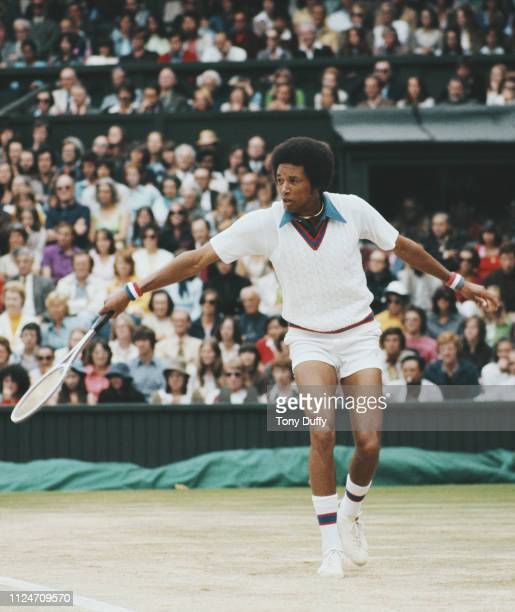 Arthur Ashe of the United States makes a backhand return to Jimmy Connors on his way to winning the Men's Singles Final match at the Wimbledon Lawn...