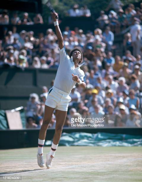Arthur Ashe of the United States serves during the 1975 Wimbledon Lawn Tennis Championships at the All England Lawn Tennis And Croquet Club in...