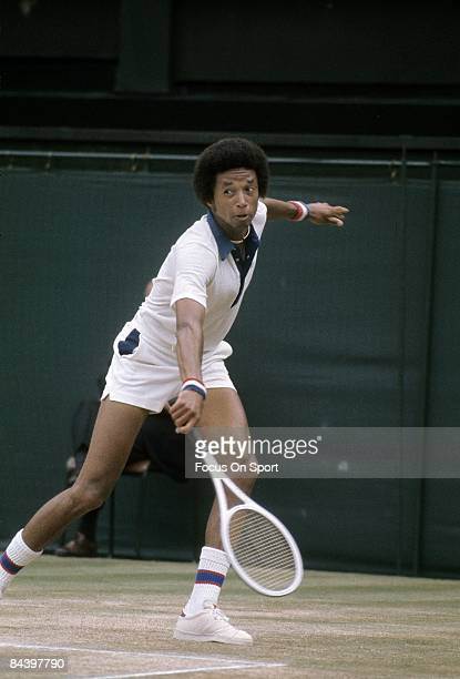 Arthur Ashe of the USA plays a backhand against his opponent during the men's singles play of the Wimbledon Lawn Tennis Championships at the All...