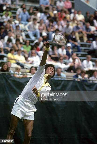Arthur Ashe of the USA serving against his opponent during the men's singles play of the Wimbledon Lawn Tennis Championships at the All England Lawn...