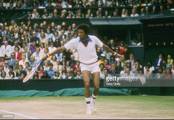 Arthur Ashe runs for the ball during a match at Wimbledon in England.