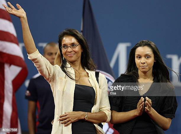 Arthur Ashe's wife Jeannie and daughter Camren walk on court for the opening ceremonies during Day 1 of the 2008 US Open at the USTA Billie Jean King...