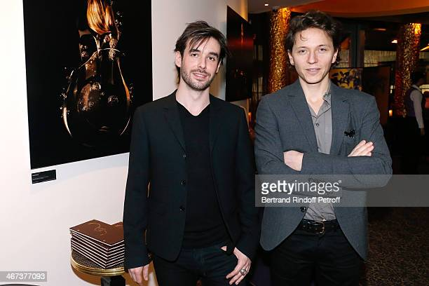 Arthur Aubert and singer Raphael attend the Arthur Aubert Exhibition private view Held at Le Fouquet's Barriere Hotel on February 6 2014 in Paris...