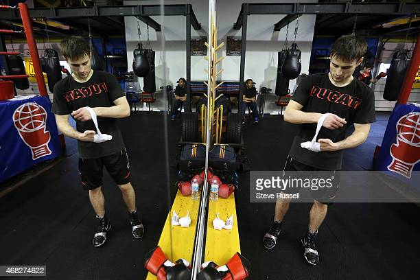 Arthur Biyarslanov wraps his hands before training he is a new Canadian originally from Chechnya who will be boxing for Canada at the Pan Am Games He...