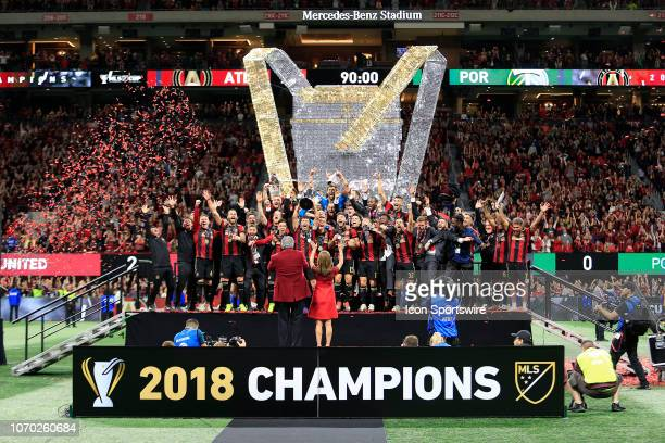 Arthur Blank and the team celebrate after winning the MLS Cup over the Portland Timbers on December 8 2018 at the MercedesBenz Stadium in Atlanta GA
