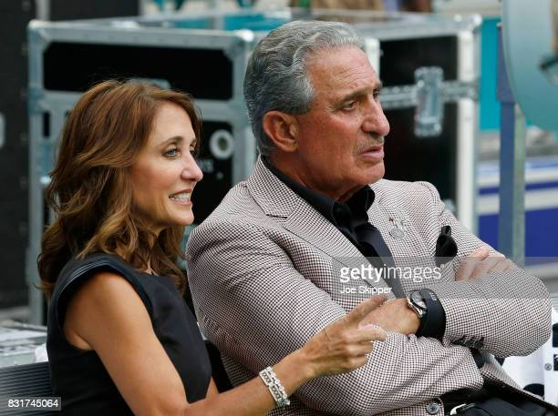Arthur Blank owner of the Atlanta Falcons sits with his wife Angela Macuga before the start of play between the Falcons and the Miami Dolphins during...