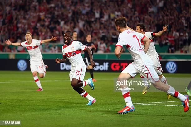 Arthur Boka of Stuttgart celebrates his team's first goal with team mates during the DFB Cup Semi Final match between VfB Stuttgart and SC Freiburg...