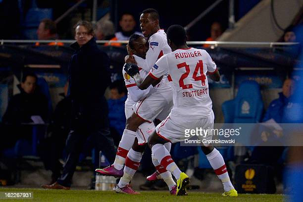 Arthur Boka of Stuttgart celebrates with teammates after scoring a goal during the UEFA Europa League Round of 32 second leg match between KRC Genk...