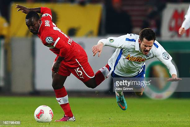 Arthur Boka of Stuttgart is challenged by Michael Delura of Bochum during the DFB Cup Quarter Final match between VfB Stuttgart and VfL Bochum at the...