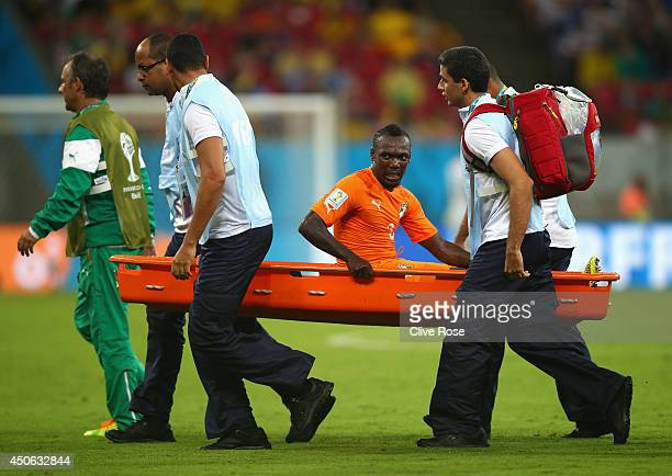 Arthur Boka of the Ivory Coast is carried off the field during the 2014 FIFA World Cup Brazil Group C match between the Ivory Coast and Japan at...