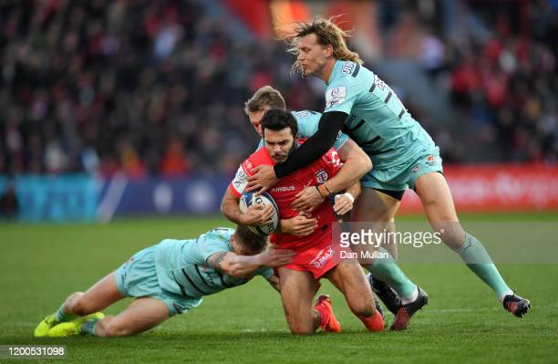 Arthur Bonneval of Toulouse is tackled by Jason Woodward, Ollie Thorley and Billy Twelvetrees of Gloucester during the Heineken Champions Cup Round 6...