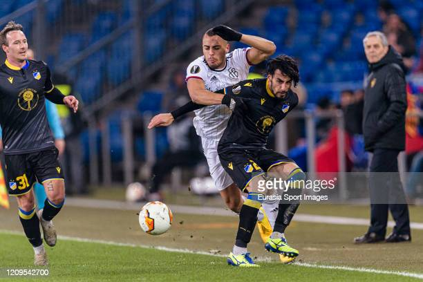 Arthur Cabral of Basel battles for the ball with Praxitelis Vouros of Apoel during the UEFA Europa League round of 32 second leg match between FC...