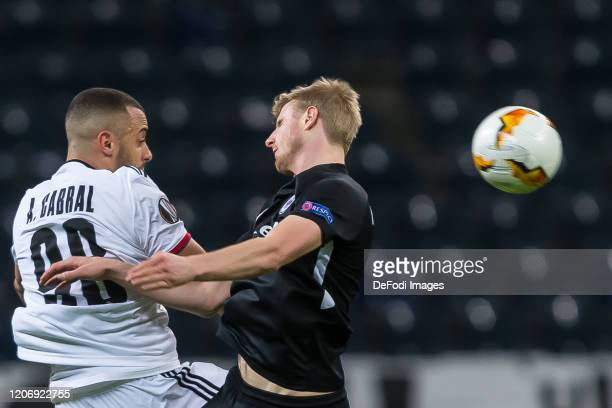 Arthur Cabral of FC Basel 1893 and Martin Hinteregger of Eintracht Frankfurt battle for the ball during the UEFA Europa League round of 16 first leg...