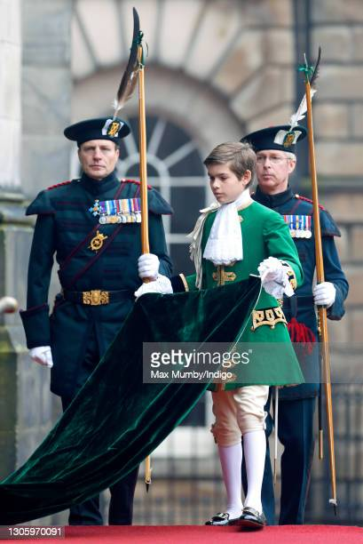 Arthur Chatto, Page of Honour to Queen Elizabeth II carries The Queen's train as she attends the biennial Order of the Thistle Service at The Thistle...