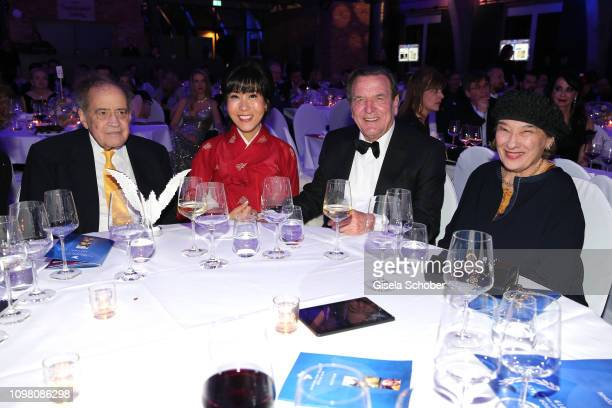 Arthur Cohn, Soyeon Schroeder-Kim, Gerhard Schroeder, Naomi Cohn during the Cinema for Peace Gala at the Westhafen Event & Convention Center on...