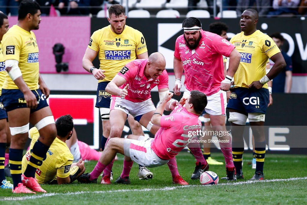 Arthur Coville #20 of Stade Francais Paris just scored a try and celebrates with Sergio Parisse #8 and Ramiro Herrera #23 of Stade Francais Paris during the French Top 14 match between Stade Francais Paris and ASM Clermont Auvergne at Stade Jean Bouin on April 7, 2018 in Paris, France.