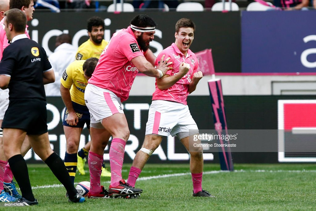 Arthur Coville #20 of Stade Francais Paris just scored a try and celebrates with Ramiro Herrera #23 of Stade Francais Paris during the French Top 14 match between Stade Francais Paris and ASM Clermont Auvergne at Stade Jean Bouin on April 7, 2018 in Paris, France.