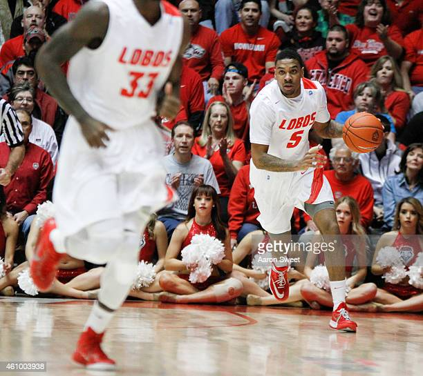 Arthur Edwards of the New Mexico Lobos dribbles the ball up court during the game against the Colorado State Rams at The WisePies Arena on January 3...