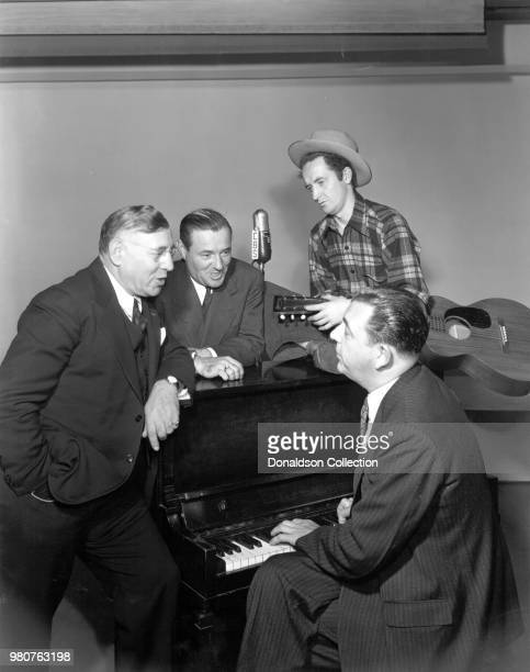 Arthur Fields Woody Guthrie and Fred Hall stars of Pipe Smoking Time radio show on CBS in 1940 New York New York