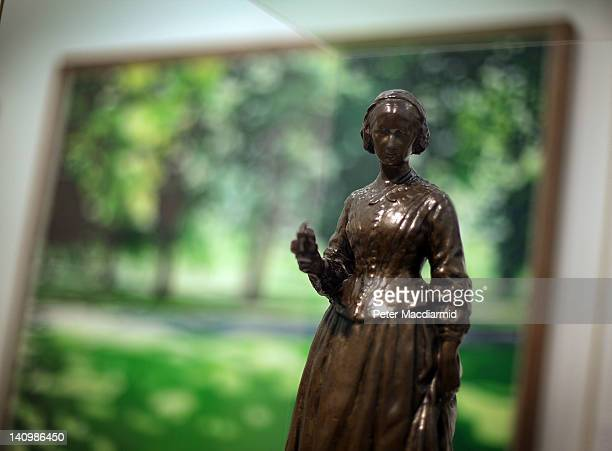 Arthur George Walker's bronze of Florence Nightingale is displayed in front of Mike Silva's Pathway through Park 2000 at The Whitechapel Gallery...